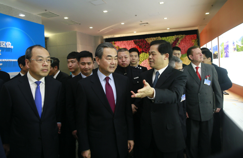 Chinese Foreign Minister Wang Yi (middle), governor of Yunnan Ruan Chengfa (left) and Chen Hao, secretary of the CPC Yunnan Provincial Committee, watch an exhibition on Yunnan in Beijing on Monday, February 20, 2017. [Photo: mfa.gov.cn]