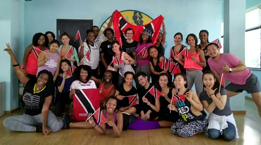 With Trinidad and Tobago's flag in hand, participants of Soca Zumba strike a pose. The event was held on February 25 at Caravan in Jianguomen.