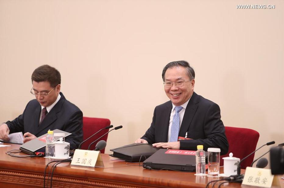 Wang Guoqing (R), spokesperson for the fifth session of the 12th Chinese People