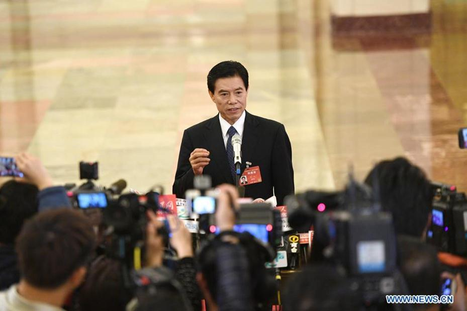Chinese Commerce Minister Zhong Shan receives an interview before the opening of the fifth session of the 12th National Committee of the Chinese People