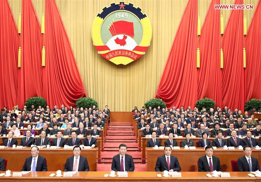 Xi Jinping (3rd L, front), Li Keqiang (3rd R, front), Zhang Dejiang (2nd L, front), Liu Yunshan (2nd R, front), Wang Qishan (1st L, front) and Zhang Gaoli (1st R, front) attend the opening meeting of the fifth session of the 12th National Committee of the Chinese People