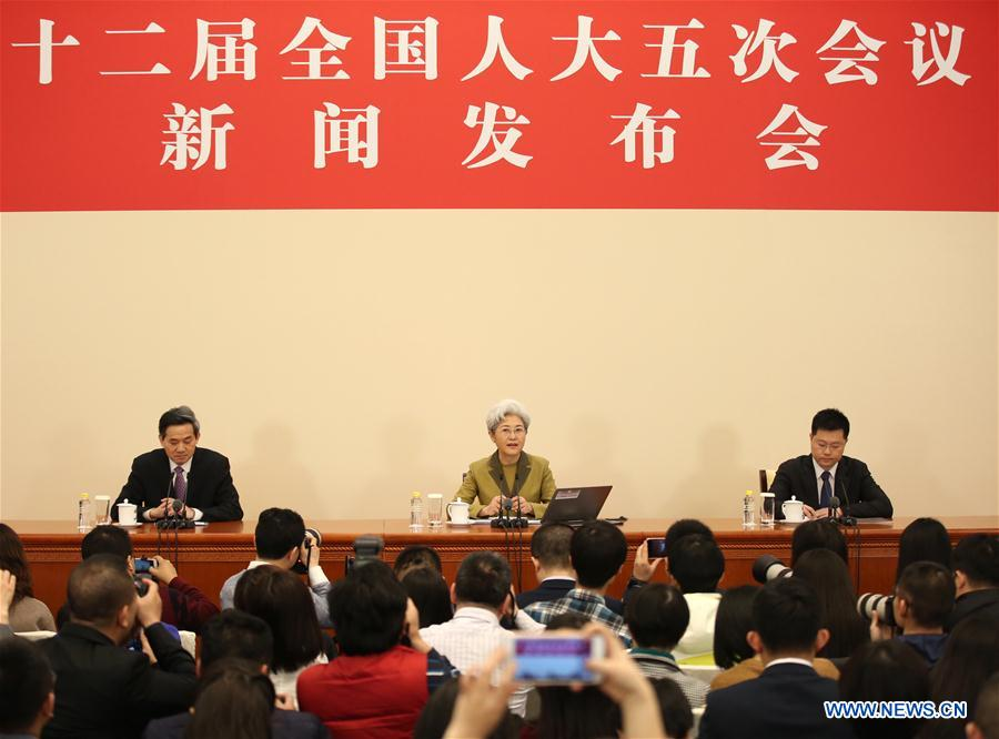 Fu Ying (C, rear), spokesperson for the fifth session of China