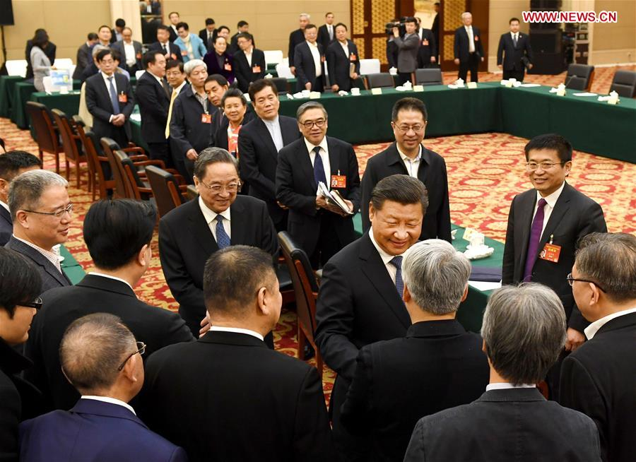 Chinese President Xi Jinping joins a panel discussion with political advisors from the China Association for Promoting Democracy, the Chinese Peasants and Workers Democratic Party and the Jiu San Society at the fifth session of the 12th National Committee of the Chinese People
