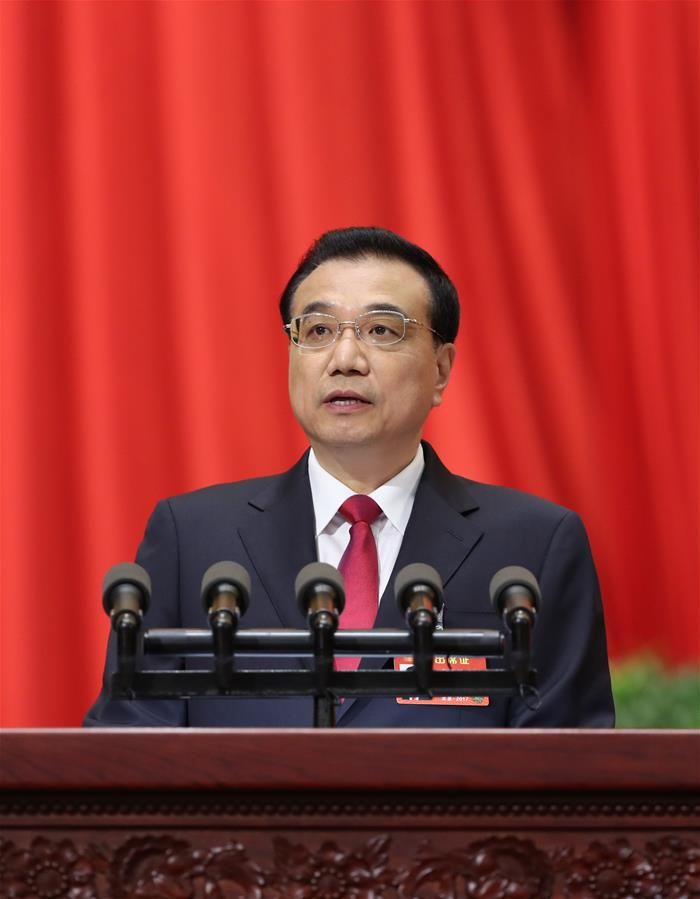 Chinese Premier Li Keqiang delivers a government work report during the opening meeting of the fifth session of China
