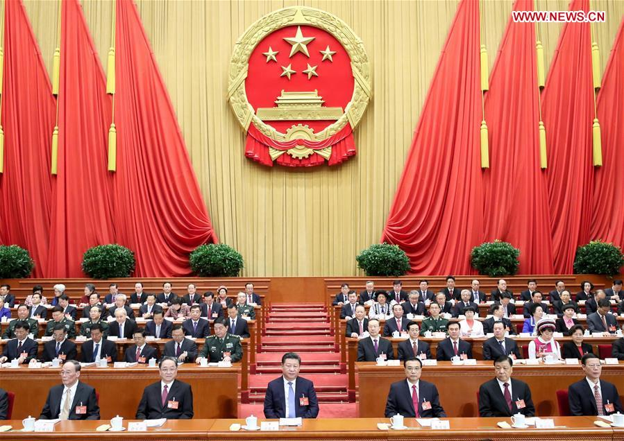 Top Communist Party of China and state leaders Xi Jinping (3rd L, front), Li Keqiang (3rd R, front), Yu Zhengsheng (2nd L, front), Liu Yunshan (2nd R, front), Wang Qishan (1st L, front) and Zhang Gaoli (1st R, front) attend the opening meeting of the fifth session of the 12th National People