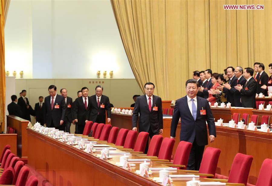 Top Communist Party of China and state leaders Xi Jinping, Li Keqiang, Zhang Dejiang, Yu Zhengsheng, Liu Yunshan, Wang Qishan and Zhang Gaoli attend the opening meeting of the fifth session of the 12th National People