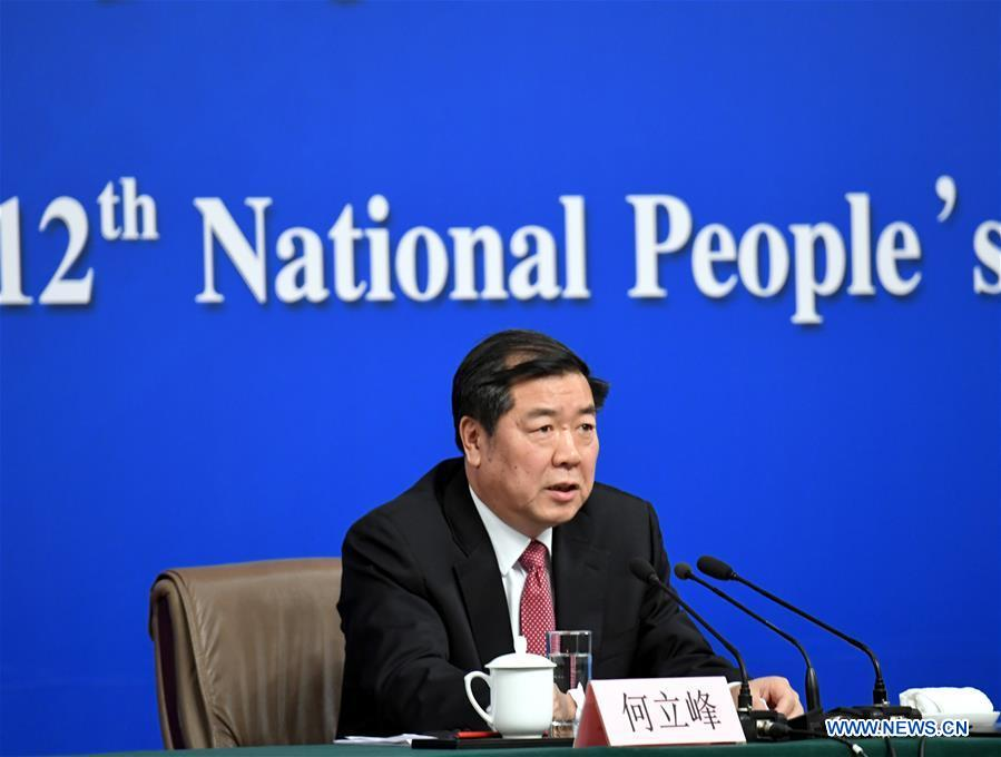 Director of the National Development and Reform Commission (NDRC) He Lifeng answers questions during a press conference on China