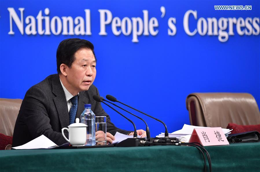 Chinese Minister of Finance Xiao Jie answers questions on reform of fiscal and taxation system and financial work at a press conference for the fifth session of the 12th National People