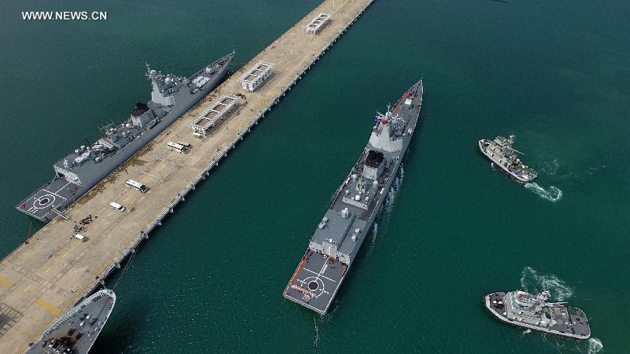Missile destroyer Changsha (R) returns to a port in Sanya City, south China