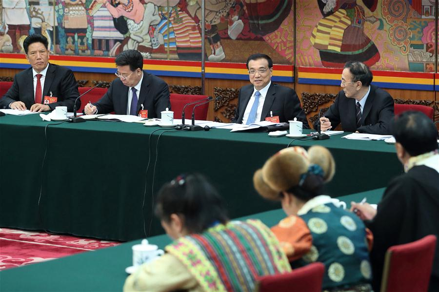 Chinese Premier Li Keqiang joins a panel discussion with deputies to the 12th National People