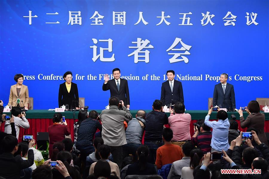 Xiao Yaqing, head of State-owned Assets Supervision and Administration Commission (SASAC), Zhang Xiwu and Huang Danhua, deputy heads of the SASAC, and Peng Huagang, deputy secretary and spokesperson of the SASAC, greet journalists at a press conference on reform of state-owned enterprises for the fifth session of the 12th National People