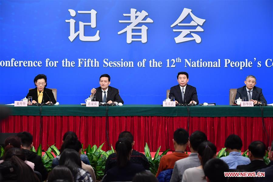 Xiao Yaqing, head of State-owned Assets Supervision and Administration Commission (SASAC), Zhang Xiwu and Huang Danhua, deputy heads of the SASAC, and Peng Huagang, deputy secretary and spokesperson of the SASAC, take questions on reform of state-owned enterprises at a press conference for the fifth session of the 12th National People