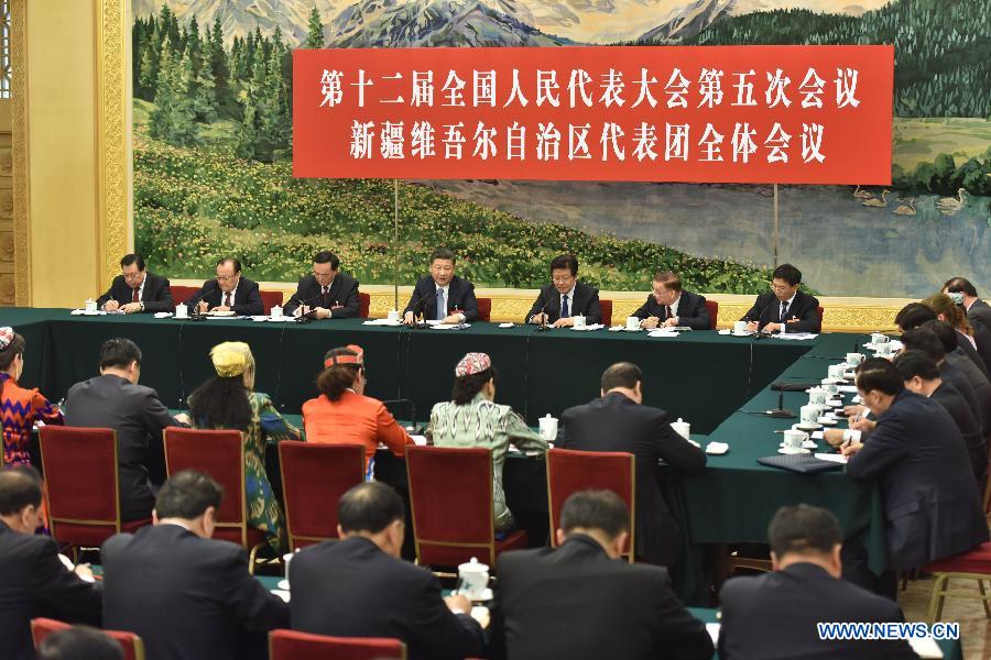 Chinese President Xi Jinping joins a panel discussion with deputies to the 12th National People