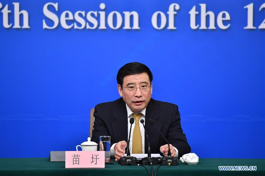 """Miao Wei, Minister of Industry and Information Technology, answers questions at a press conference on """"Made in China 2025"""" plan for the fifth session of the 12th National People"""