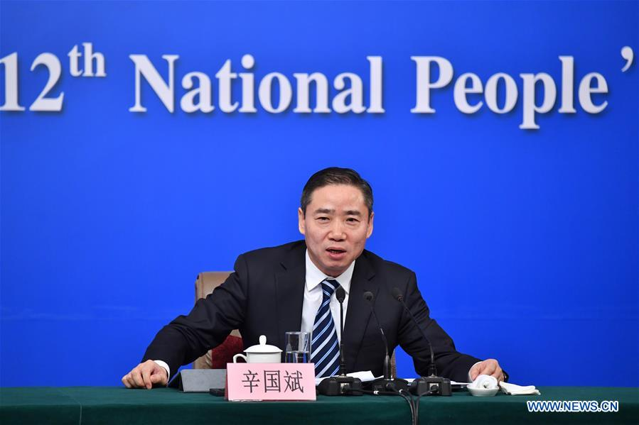 "Xin Guobin, Vice Minister of Industry and Information Technology, answers questions on ""Made in China 2025"" plan at a press conference for the fifth session of the 12th National People"