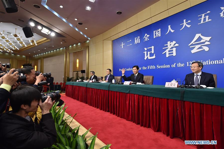 Chinese Minister of Commerce Zhong Shan, vice ministers Wang Shouwen and Qian Keming take questions at a press conference on structural adjustments and innovation for the fifth session of the 12th National People