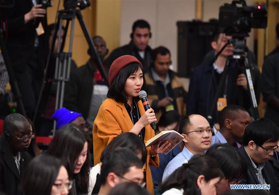 A journalist asks questions at a press conference by Chinese Minister of Commerce Zhong Shan, vice ministers Wang Shouwen and Qian Keming on structural adjustments and innovation for the fifth session of the 12th National People