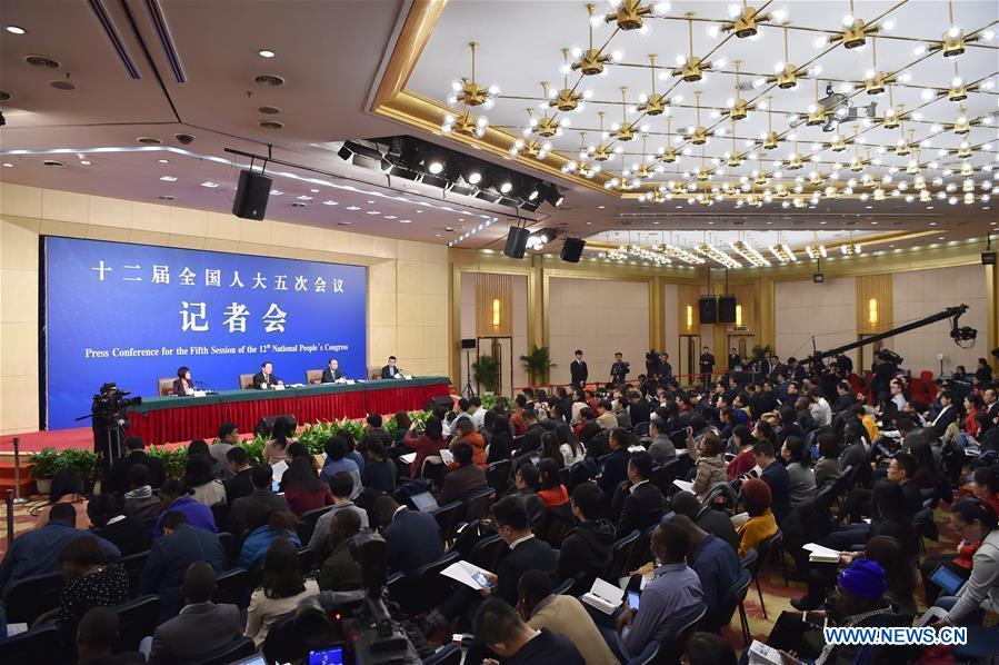 Chinese Science and Technology Minister Wan Gang and Secretary-General Xu Jianpei take questions on innovation-driven development at a press conference for the fifth session of the 12th National People