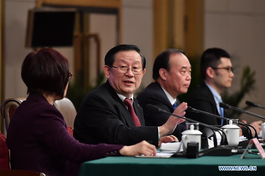 Chinese Science and Technology Minister Wan Gang (2nd L) answers questions on innovation-driven development at a press conference for the fifth session of the 12th National People