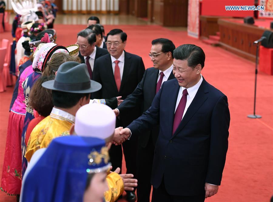 Top Communist Party of China and state leaders Xi Jinping, Li Keqiang, Zhang Dejiang, Yu Zhengsheng, Liu Yunshan, Wang Qishan and Zhang Gaoli attend a gathering with ethnic minority deputies to the 12th National People