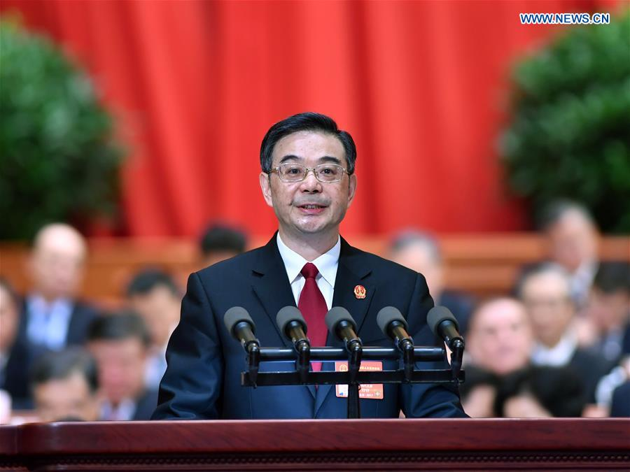 Chief Justice Zhou Qiang delivers a work report of the Supreme People