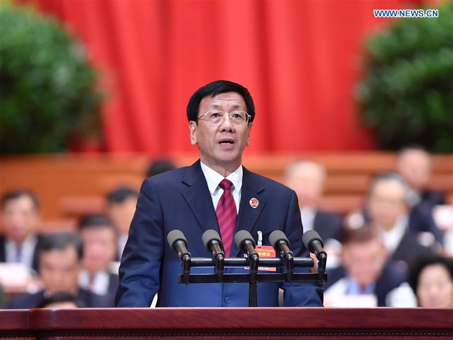 Procurator-General Cao Jianming delivers a work report of the Supreme People