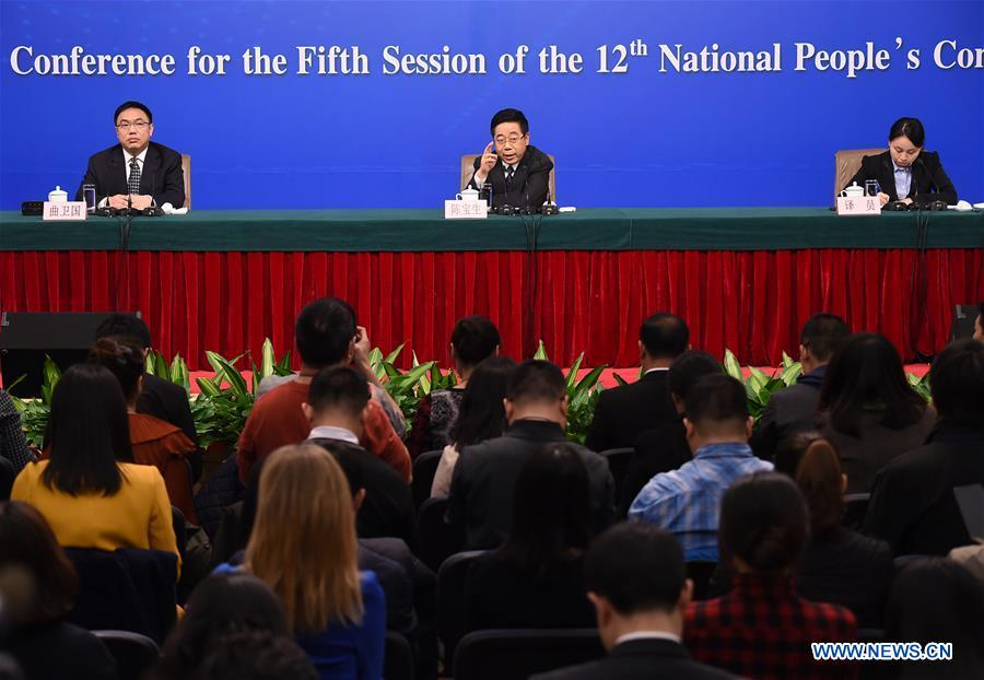 Chinese Minister of Education Chen Baosheng answers questions at a press conference on education reform and development for the fifth session of the 12th National People