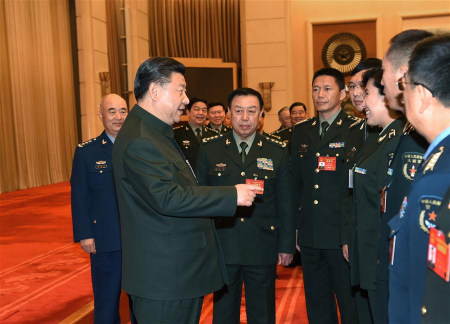 Chinese President Xi Jinping, also general secretary of the Communist Party of China Central Committee and chairman of the Central Military Commission, meets with deputies from grassroots units to the 12th National People