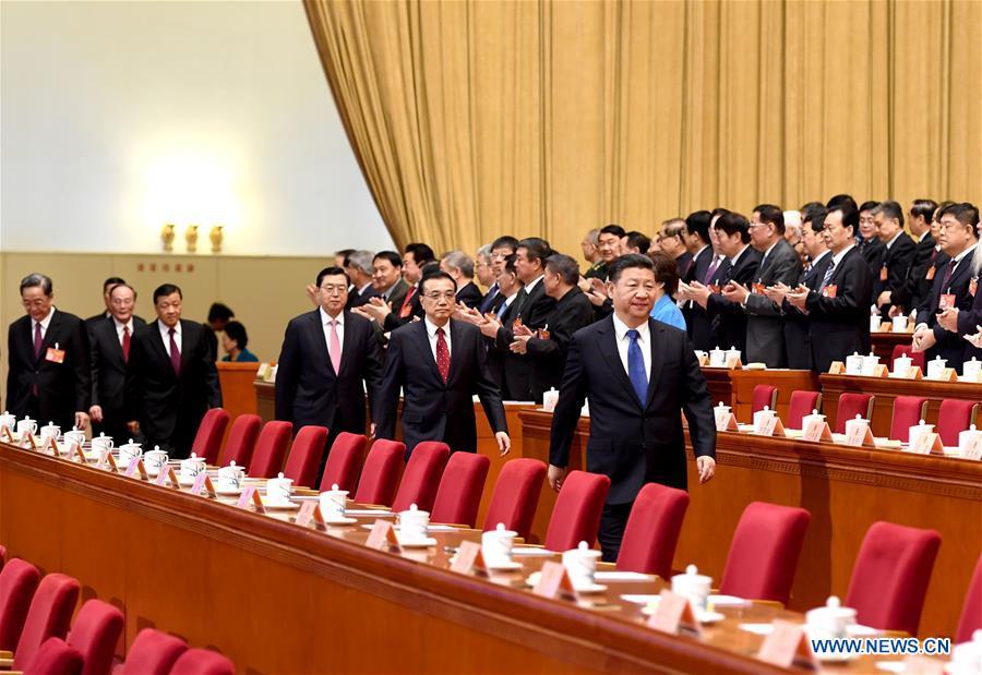 Xi Jinping, Li Keqiang, Zhang Dejiang, Yu Zhengsheng, Liu Yunshan, Wang Qishan and Zhang Gaoli walk onto the rostrum during the closing meeting of the fifth session of the 12th National Committee of the Chinese People