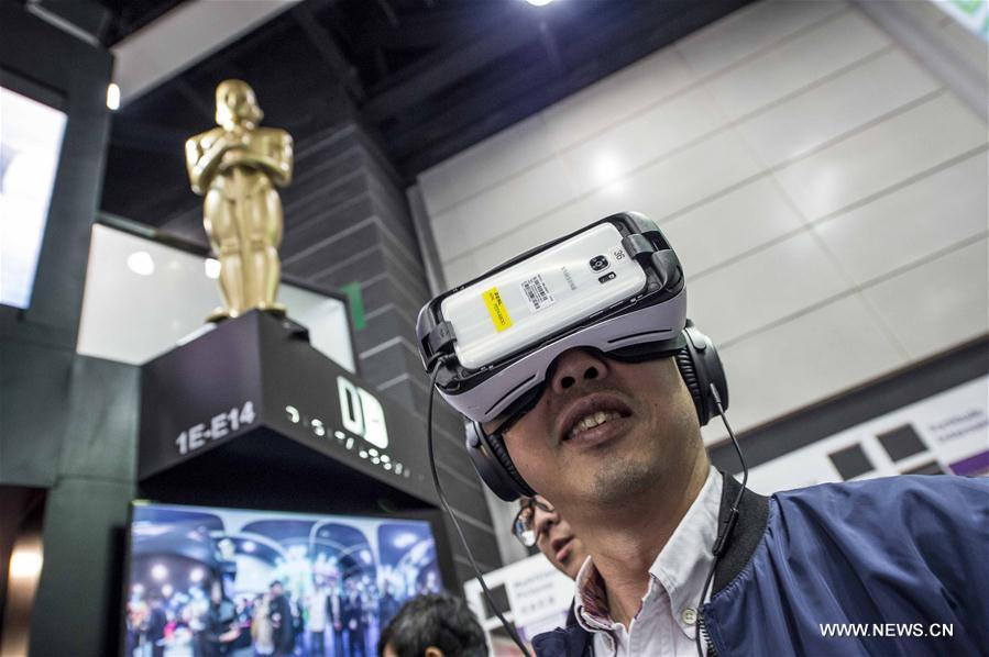 A man watches VR films at Hong Kong International Film & TV Market (FILMART) in Hong Kong, south China, March 13, 2017. The FILMART, with the participation of over 800 exhibitors from 35 countries and regions, kicked off here Monday. (Xinhua/Lui Siu Wai)