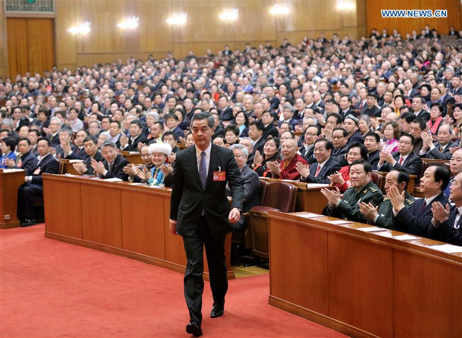 Leung Chun-ying walks to the rostrum after being elected vice chairman of the 12th National Committee of the Chinese People