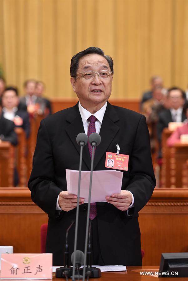 Yu Zhengsheng, président du Comité national de la Conférence consultative politique du Peuple chinois (CCPPC), préside la réunion de clôture de la 5e session du 12e Comité national de la CCPPC, l
