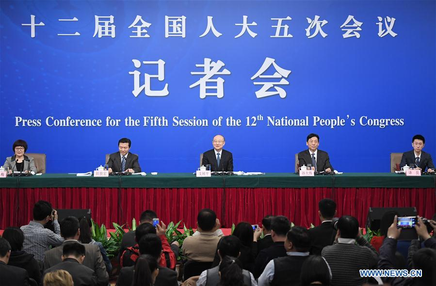 Zhi Shuping, director of the General Administration of Quality Supervision, Inspection and Quarantine, his deputy Sun Dawei, and Tian Shihong, head of the Standardization Administration of China, take questions at a press conference on quality improvement for the fifth session of the 12th National People