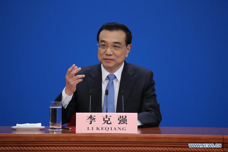 Chinese Premier says no intention of devaluing yuan to boost exports