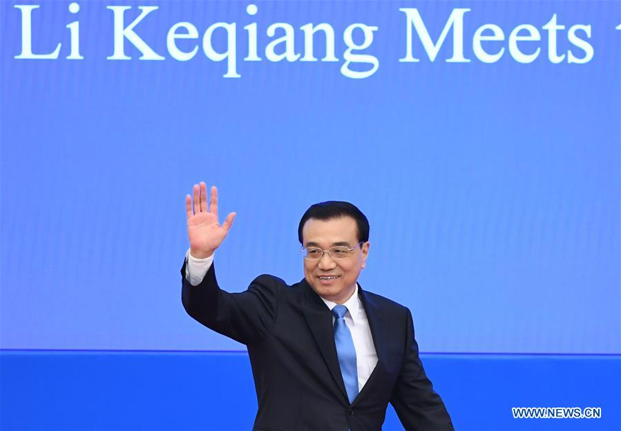 Chinese Premier Li Keqiang arrives for a press conference at the Great Hall of the People in Beijing, capital of China, March 15, 2017. (Xinhua/Jin Liangkuai)