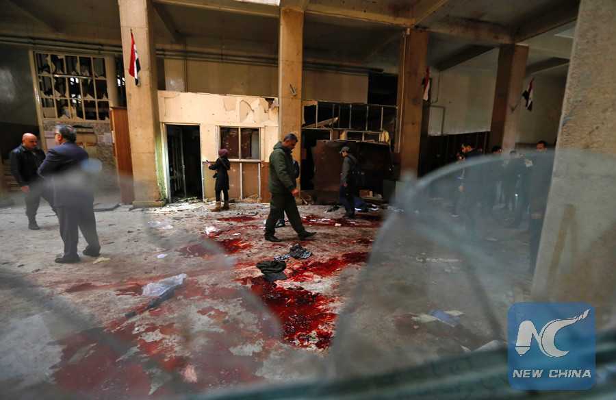 Syrian security forces inspect the scene of a reported suicide bombing at the old palace of justice building in Damascus on March 15, 2017. (AFP photo)