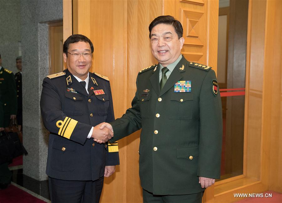 Chinese State Councilor and Defense Minister Chang Wanquan (R) meets with Pham Hoai Nam, commander of the Vietnam People