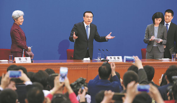 Premier Li Keqiang speaks to reporters at the conclusion of a news conference after the closing session of the National People