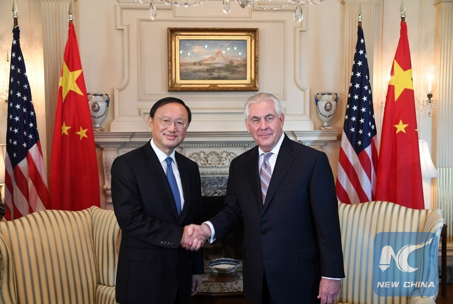 Chinese State Councilor Yang Jiechi (L) shakes hands with U.S. Secretary of State Rex Tillerson during their meeting in Washington D.C., the United States, on Feb. 28, 2017. (Xinhua/Yin Bogu)