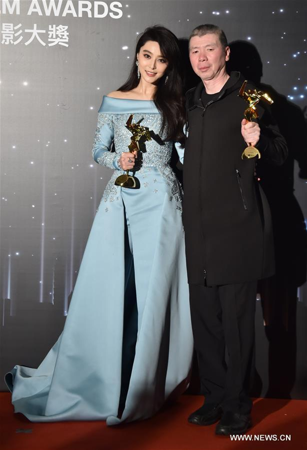 """Chinese actress Fan Bingbing (L) and director Feng Xiaogang pose for photos during the presentation ceremony of the 11th Asian Film Awards in Hong Kong, south China, March 21, 2017. Fan Bingbing won the Best Actress Award for film """"I am not Madame Bovary"""", and the film, directed by Feng Xiaogang, won the Best Film Award. (Xinhua/Lui Siu Wai)"""