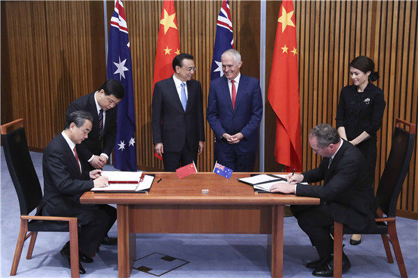 Premier Li Keqiang and Australian Prime Minister Malcolm Turnbull witnessed the signing of eight cooperation documents at Parliament House in Canberra on March 24.