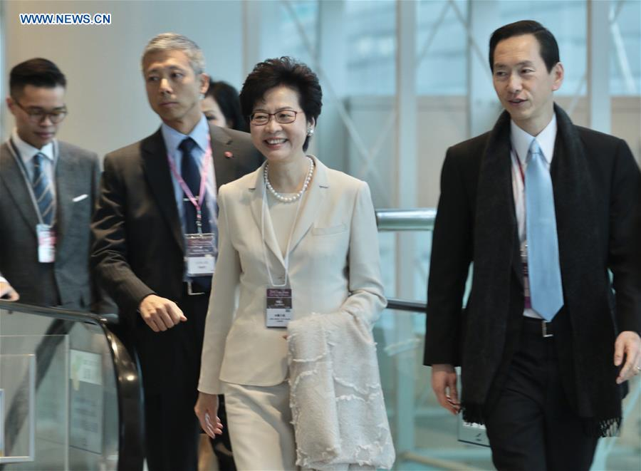 Lam Cheng Yuet-ngor (2nd R) arrives at the Hong Kong Convention and Exhibition Center before the voting for the fifth-term chief executive of China