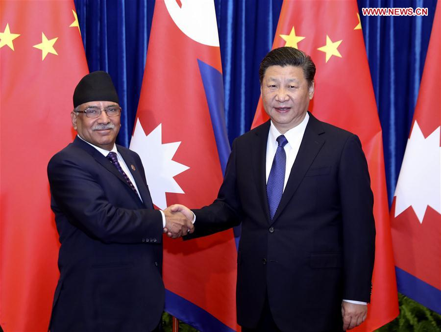 Chinese PresidentXi Jinping(R) meets with Nepali Prime Minister Pushpa Kamal Dahal in Beijing, capital of China, March 27, 2017.(Xinhua/Ding Lin)