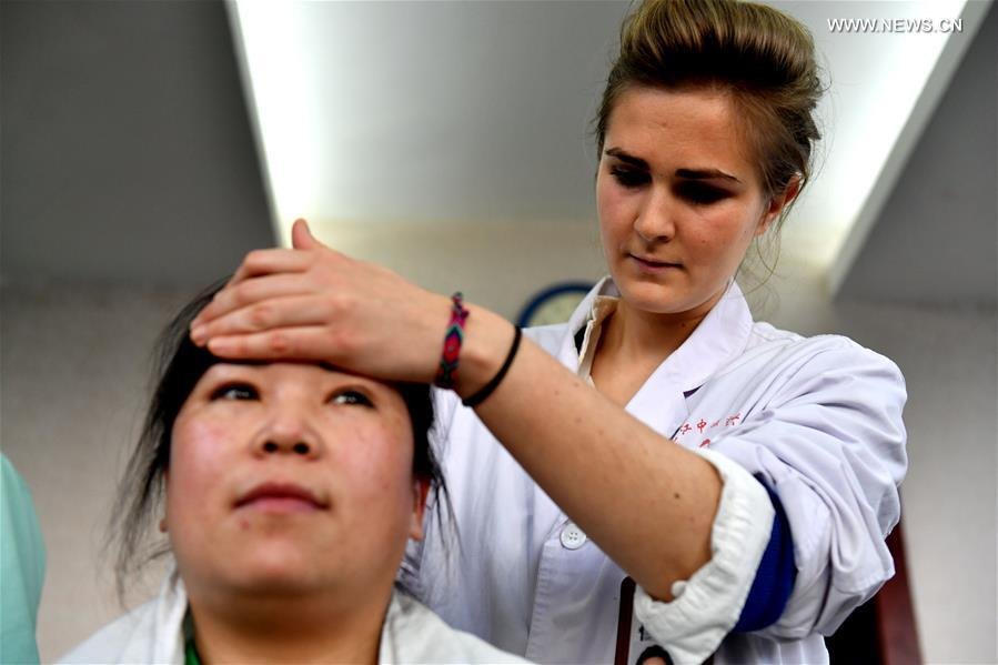 Anaelle, a graduate of Heilongjiang University of Chinese Medicine from France, carries out manipulation at the First Affiliated Hospital of Heilongjiang University of Chinese Medicine in Harbin, capital of northeast China