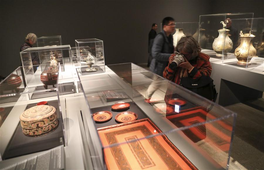 A visitor takes photos of an artwork during a media preview of the Exhibition of Civilization of the Qin and Han Dynasties (221 B.C.-220 A.D.) in The Metropolitan Museum of Art, New York, the United States, on March 27, 2017. The exhibition featuring more than 160 objects of ancient Chinese art, will be opened to public from April 3 to July 16 in The Metropolitan Museum of Art. (Xinhua/Wang Ying)