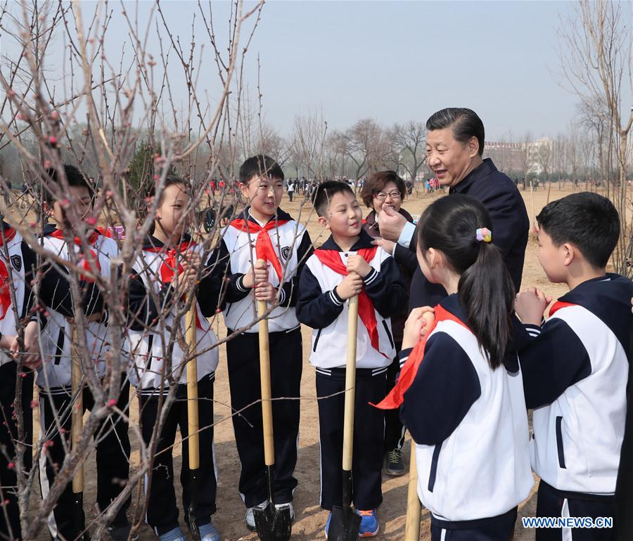 Chinese PresidentXi Jinpingtalks with students as he attends a tree planting activity in Beijing, capital of China, March 29, 2017. China