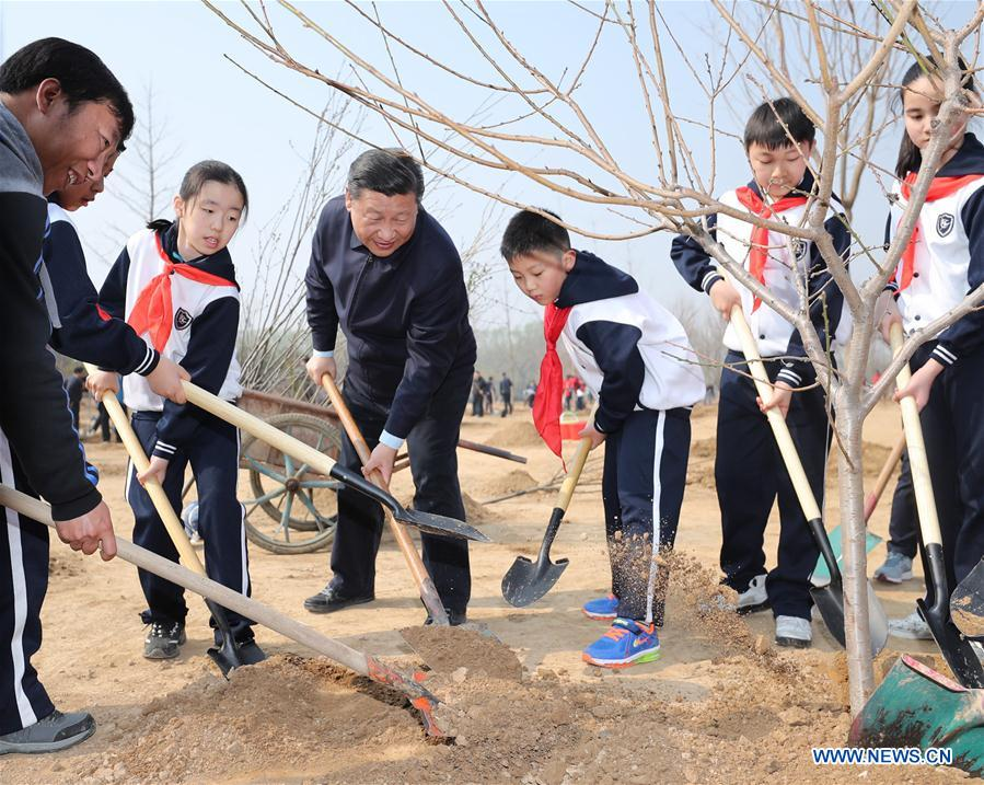 Chinese President Xi Jinping plants a sapling as he attends a tree planting activity in Beijing, capital of China, March 29, 2017. China