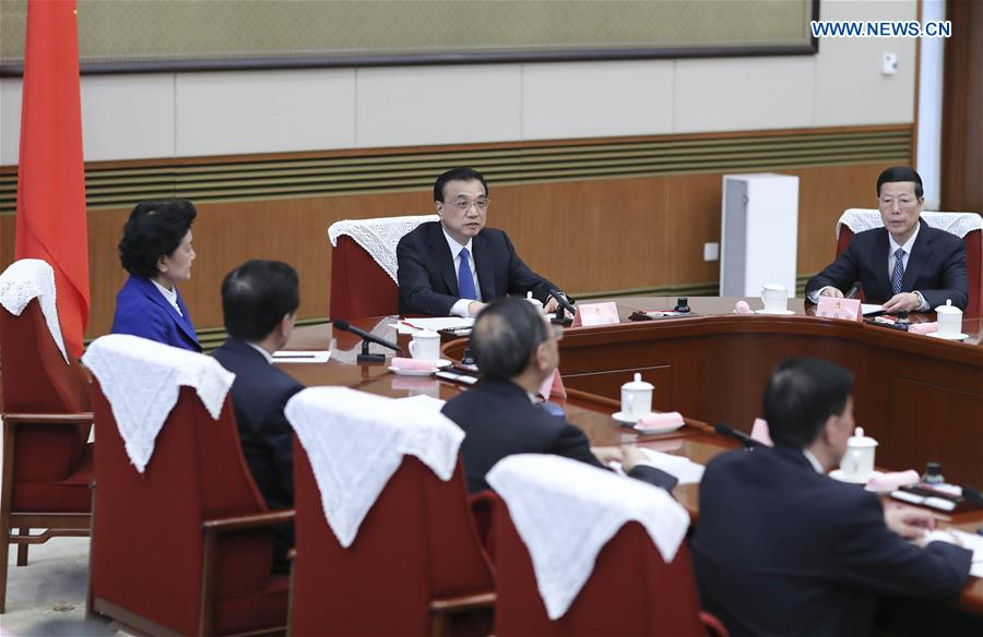 Chinese Premier Li Keqiang (C) presides over the 7th plenary meeting of the State Council in Beijing, capital of China, March 31, 2017. The State Council decided at the meeting to appoint Lam Cheng Yuet-ngor the fifth-term chief executive of Hong Kong Special Administrative Region. Lam will assume office on July 1, 2017. (Xinhua/Ding Lin)