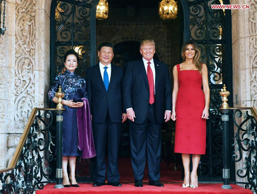 Chinese President Xi Jinping (2nd L) and his wife Peng Liyuan (1st L) pose for a photo with U.S. President Donald Trump (2nd R) and First Lady Melania Trump in the Mar-a-Lago resort in Florida, the United States, April 6, 2017. Chinese President Xi Jinping met with his U.S. counterpart Donald Trump here on Thursday. (Xinhua/Rao Aimin)