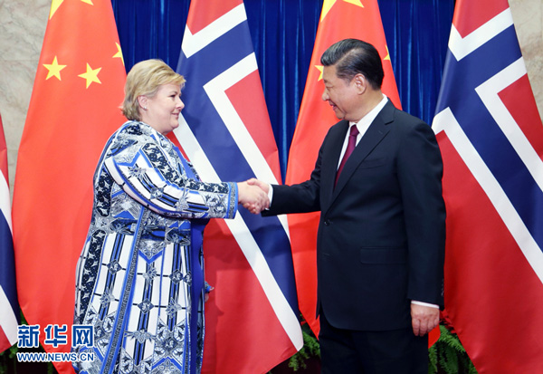 President Xi Jinping met visiting Norwegian Prime Minister Erna Solberg in Beijing Monday, voicing hope that the two countries could cement political mutual trust.